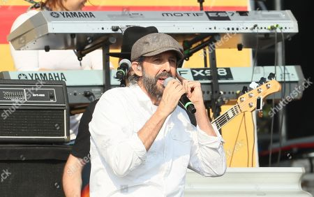 Dominican singer Juan Luis Guerra performs during the Aid Live concert, funded by British billionaire Richard Branson, at the Tienditas border bridge in Cucuta, Colombia, 22 February 2019.