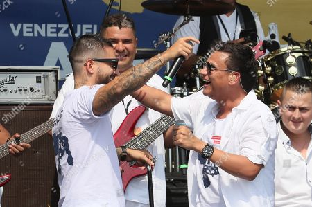 Colombian singer Maluma and Silvestre Dangond perform on stage during the Aid Live concert, funded by British billionaire Richard Branson, at the Tienditas border bridge in Cucuta, Colombia, 22 February 2019.