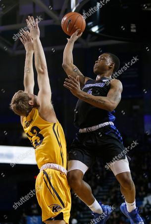 Buffalo forward Davonta Jordan (4) drives against Kent State guard Mitch Peterson (13) during the second half of an NCAA college basketball game, in Buffalo, N.Y