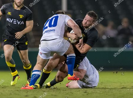 Houston SaberCats prop Jake Turnbull (17) is tackled by Toronto Arrows lock Andrew Wilson (20) during the match between the Toronto Arrows and the Houston SaberCats at Constellation Field, Sugar Land, Texas. Full Time Toronto Arrows beat the Houston SaberCats 44-27. ©Maria Lysaker / Cal Sports Media