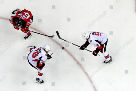 New Jersey Devils left wing Jesper Bratt (63), of Sweden, competes for the puck with Ottawa Senators center Filip Chlapik (78), of the Czech Republic, and defenseman Cody Ceci (5) during the second period of an NHL hockey game, in Newark, N.J. The Devils won 4-0