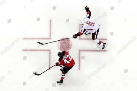 New Jersey Devils left wing Brett Seney (43) drives against Ottawa Senators defenseman Cody Ceci (5) during the second period of an NHL hockey game, in Newark, N.J. The Devils won 4-0