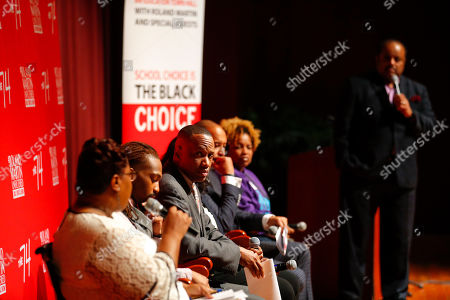 """Gavin Samms, founder of Genesis Innovation Academy, listens to fellow panelists for """"Is School Choice the Black Choice,"""" an education town hall hosted by broadcast journalist Roland Martin on the campus of Morehouse College on in Atlanta"""