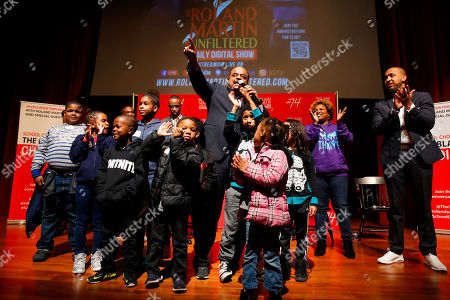 """Children stand on stage following """"Is School Choice the Black Choice,"""" an education town hall led by broadcast journalist Roland Martin on the campus of Morehouse College on in Atlanta"""