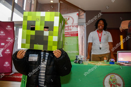 """A child attends the partner fair ahead of """"Is School Choice the Black Choice,"""" an education town hall hosted by broadcast journalist Roland Martin on the campus of Morehouse College on in Atlanta"""