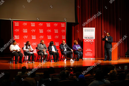 """Stock Image of Broadcast journalist Roland Martin moderates the panel for """"Is School Choice the Black Choice,"""" on the campus of Morehouse College on in Atlanta. The education town hall featured Georgia Rep. Valencia Stovall, writer Jason Allen, Genesis Innovation Academy Founder Gavin Samms, EdConnect CEO Danielle LeSure, Progressive Policy Institute's Curtis Valentine, and Atlanta Thrive Parent Organizer Aretta Baldon"""