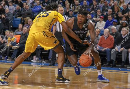 Buffalo Bulls forward Nick Perkins (33) drives the baseline past Kent State Golden Flashes forward Philip Whittington (25) during the first half of play in the NCAA Basketball game between the Kent State Golden Flashes and Buffalo Bulls at Alumni Arena in Amherst, N.Y. (Nicholas T