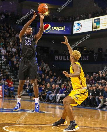 Buffalo Bulls forward Nick Perkins (33) shoots for two of his career high 27 points during the first half of play in the NCAA Basketball game between the Kent State Golden Flashes and Buffalo Bulls at Alumni Arena in Amherst, N.Y. (Nicholas T