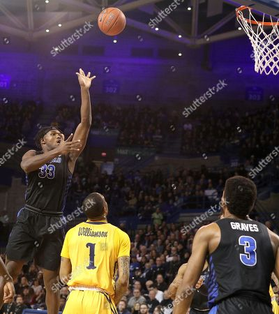 Buffalo Bulls forward Nick Perkins (33) shoots over Kent State Golden Flashes guard C.J. Williamson (1) during the first half of play in the NCAA Basketball game between the Kent State Golden Flashes and Buffalo Bulls at Alumni Arena in Amherst, N.Y. (Nicholas T