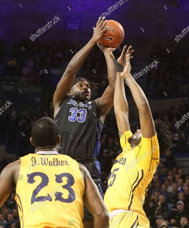 Buffalo Bulls forward Nick Perkins (33) shoots over Kent State Golden Flashes forward Philip Whittington (25) for two of his career high 27 points during the first half of play in the NCAA Basketball game between the Kent State Golden Flashes and Buffalo Bulls at Alumni Arena in Amherst, N.Y. (Nicholas T