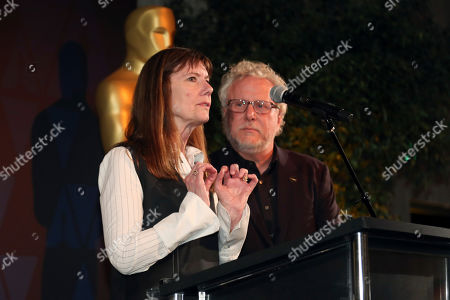 Stock Image of Diane Weyermann, Larry Karaszewski. Diane Weyermann, left, and Larry Karaszewski speak at the 91st Academy Awards Foreign Language Nominees Reception at the LACMA, in Los Angeles