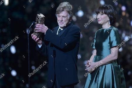 Robert Redford receives an honorary Cesar award from Kristin Scott Thomas