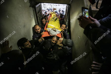 Palestinians carry the body of 15-year-old Youssef Al-Daya during his funeral in the east of Gaza City, 23 February 2019. Al-Daya was shot dead the previous day by Israeli sniper during another round of protests near the border between Israel and eastern Gaza Strip.