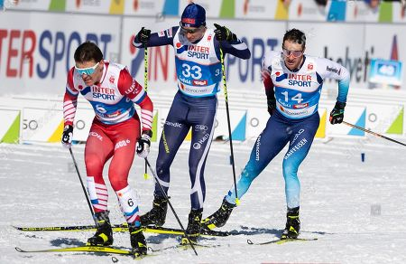 Russia's Andrey Melnichenko, Finnland's Matti Heikkinien and Switzerland's Dario Cologna, from left, in action during the men 30km cross country skiathlon in the Cross Country Arena at the 2019 Nordic Skiing World Championships in Seefeld, Austria, on Saturday, 23 February 2019.