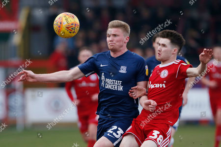 Southend United defender Taylor Moore, (23) and Accrington Stanley  forward Paul Smyth (38) contest a loose ball  during the EFL Sky Bet League 1 match between Accrington Stanley and Southend United at the Fraser Eagle Stadium, Accrington
