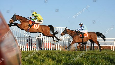 Walt and Sam Twiston-Davies jump the last to win the 888Sport Handicap Chase at Kempton from Double Shuffle for trainer Neil Mulholland.