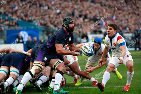 Josh Strauss of Scotland (L) in action against Antoine Dupont (R) of France during the Six Nations rugby match between France and Scotland in Saint Denis, near Paris, France, 23 February 2019.