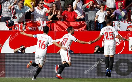 Sevilla FC's Gabriel Mercado (R) celebrates with teammates after scoring the 2-1 goal during the Spanish LaLiga soccer match played between Sevilla FC and FC Barcelona at the Sanchez Pizjuan stadium in Seville, Spain, 23 February 2019.