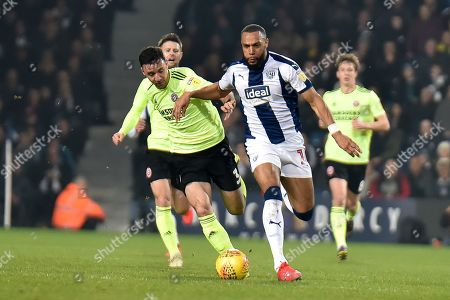 West Bromwich Albion midfielder Matt Phillips (10) sprints forward with the ball under pressure from Sheffield United defender Enda Stevens (3) during the EFL Sky Bet Championship match between West Bromwich Albion and Sheffield United at The Hawthorns, West Bromwich