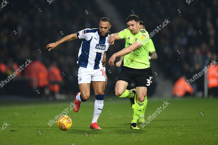 Matt Phillips of West Bromwich Albion is challenged by Enda Stevens of Sheffield United.
