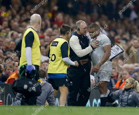 Kyle Sinckler of England is spoken to by team manager Richard Hill after he was taken off in the 2nd half