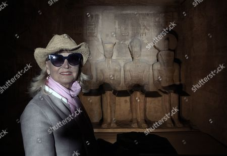 Barbara Bouchet poses inside the Great Temple of Ramses II's dark inner chamber, in Abu Simbel, 870 kilometers (540 miles) south of Cairo, Egypt, 23 February 2019. Bouchet is in the country for the third Aswan International Women Film Festival (AIWFF) running from 20 to 26 February.