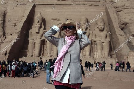 Stock Image of Barbara Bouchet poses in front of the Great Temple of Ramses II in Abu Simbel, 870 kilometers (540 miles) south of Cairo, Egypt, 23 February 2019. Bouchet is in the country for the third Aswan International Women Film Festival (AIWFF) running from 20 to 26 February.