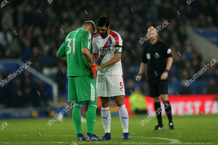 Vicente Guaita of Crystal Palace gets help from James Tomkins of Crystal Palace to do up his shorts during Leicester City vs Crystal Palace, Premier League Football at the King Power Stadium on 23rd February 2019