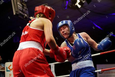 Stock Image of 69kg ñ Women's Welterweight. Christina Desmond (red) vs Grainne Walsh (blue). Christina Desmond and Grainne Walsh