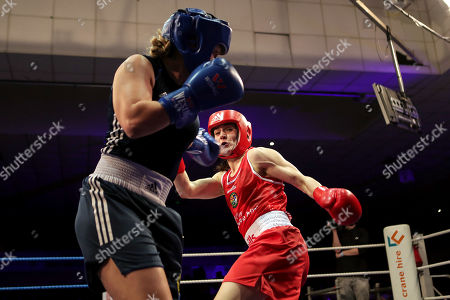 Stock Image of 60kg ñ Women's Lightweight. Kelly Harrington (red) vs Jelena Jelic (blue). Kelly Harrington and Jelena Jelic