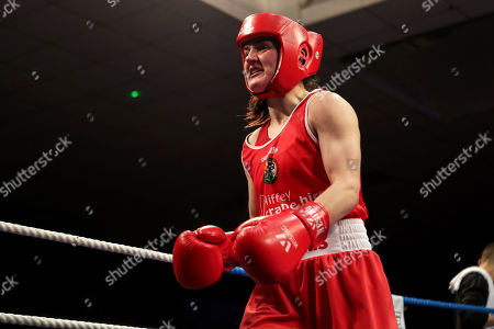 Stock Image of 60kg ñ Women's Lightweight. Kelly Harrington (red) vs Jelena Jelic (blue). Kelly Harrington celebrates