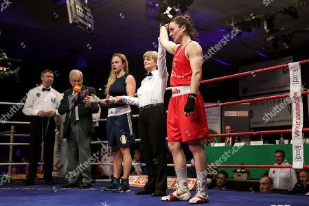 Stock Picture of 60kg ñ Women's Lightweight. Kelly Harrington (red) vs Jelena Jelic (blue). Kelly Harrington celebrates