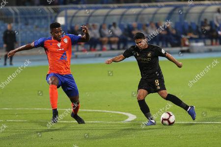 Al-Fayha player Admilson Dias Barros (L) in action for the ball with Al-Nassr player Yahya Al-Shehri (R) during the Saudi Professional League soccer match between Al-Nassr and Al-Fayha at Prince Faisal bin Fahd Stadium, Riyadh, Saudi Arabia, 23 February 2019.