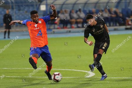 Stock Image of Al-Fayha player Admilson Dias Barros (L) in action for the ball with Al-Nassr player Yahya Al-Shehri (R) during the Saudi Professional League soccer match between Al-Nassr and Al-Fayha at Prince Faisal bin Fahd Stadium, Riyadh, Saudi Arabia, 23 February 2019.