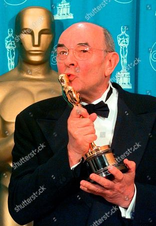 "DONEN. Director Stanley Donen kisses the Oscar he received for Lifetime Achievement backstage at the 70th Academy Awards at the Shrine Auditorium in Los Angeles. Donen, whose ""Singin' in the Rain"" provided some of the most unforgettable moments in movie history, has died, on in New York"