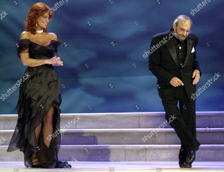 "LOREN DONEN. Italian Actress Sophia Loren looks at US Director Stanley Donen dancing on the stage, during the awarding ceremony at the 61st edition of the Venice Film Festival in Venice, northern Italy. Donen, whose ""Singin' in the Rain"" provided some of the most unforgettable moments in movie history, has died. He was 94. Donen's died in New York"
