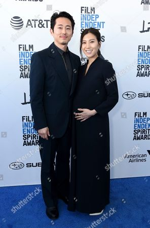 Steven Yeun, Joana Pak. Steven Yeun, left, and Joana Pak arrive at the 34th Film Independent Spirit Awards, in Santa Monica, Calif