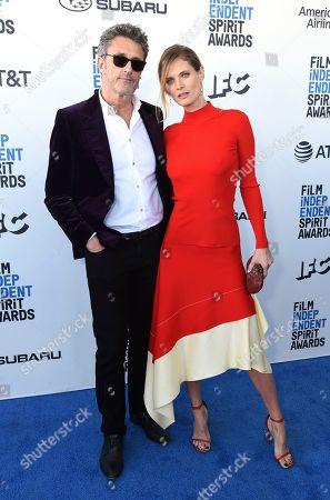 Pawel Pawlikowski, Malgosia Bela. Pawel Pawlikowski, left, and Malgosia Bela arrive at the 34th Film Independent Spirit Awards, in Santa Monica, Calif