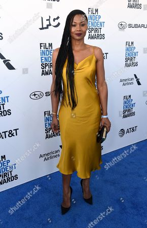Emayatzy Corinealdi arrives at the 34th Film Independent Spirit Awards, in Santa Monica, Calif