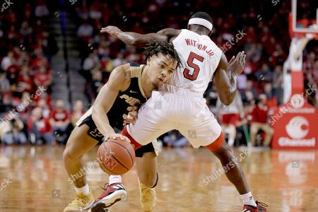 Purdue's Carsen Edwards (3) tries to drive around Nebraska's Glynn Watson Jr. (5) during the first half of an NCAA college basketball game in Lincoln, Neb