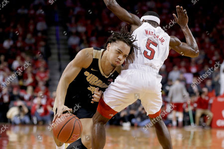 Carsen Edwards, Glynn Watson Jr. Purdue's Carsen Edwards (3) drives around Nebraska's Glynn Watson Jr. (5) during the first half of an NCAA college basketball game in Lincoln, Neb