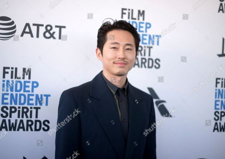 Steven Yeun arrives at the 34th Film Independent Spirit Awards, in Santa Monica, Calif