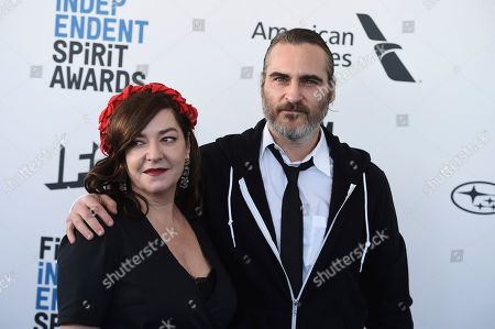 Stock Picture of Lynne Ramsay, Joaquin Phoenix. Lynne Ramsay, left, and Joaquin Phoenix arrive at the 34th Film Independent Spirit Awards, in Santa Monica, Calif