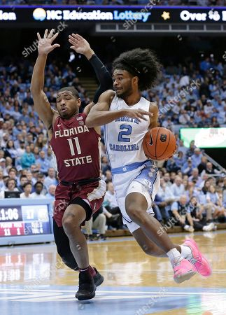 David Nichols, Coby White. North Carolina's Coby White (2) dribbles while Florida State's David Nichols (11) defends during the first half of an NCAA college basketball game in Chapel Hill, N.C