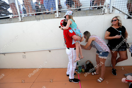 Stock Image of Boston Red Sox pitcher Steven Wright (35) holds his daughter Ella, 6, before a spring training baseball game against the New York Yankees in Fort Myers, Fla
