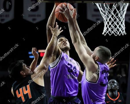 Levi Stockard III, Patrick Muldoon, Gabe Simpson. Kansas State forwards Levi Stockard III (34) and Patrick Muldoon (35) rebound against Oklahoma State guard Gabe Simpson (44) during the second half of an NCAA college basketball game in Manhattan, Kan
