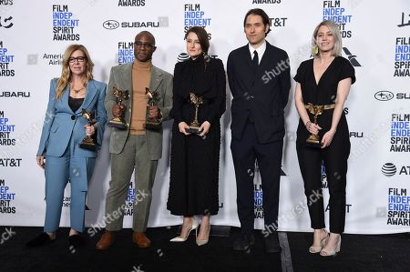 "Dede Gardner, Barry Jenkins, Adele Romanski, Jeremy Kleiner, Sara Murphy. Barry Jenkins, second from left, winner of the awards for best director and best feature, poses in the press room with Dede Gardner, from left, Adele Romanski, Jeremy Kleiner, and Sara Murphy, winners of the award for best feature all for ""If Beale Street Could Talk,"" at the 34th Film Independent Spirit Awards, in Santa Monica, Calif"