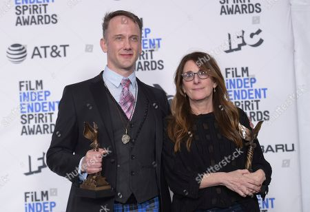"Jeff Whitty, Nicole Holofcener. Jeff Whitty, left, and Nicole Holofcener pose in the press room with the award for best screenplay for ""Can You Ever Forgive Me?"" at the 34th Film Independent Spirit Awards, in Santa Monica, Calif"
