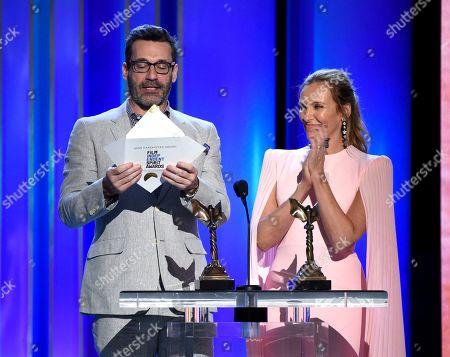 Jon Hamm, Toni Collette. Jon Hamm, left, and Toni Collette present the John Cassavetes award at the 34th Film Independent Spirit Awards, in Santa Monica, Calif