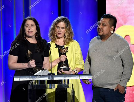 "Carolyn Kaplan, Lindsay Cordero, Genoel Ramirez. Carolyn Kaplan, from left, Lindsay Cordero, and Genoel Ramirez accept the John Cassavetes award for ""En El Septimo Dia"" at the 34th Film Independent Spirit Awards, in Santa Monica, Calif"